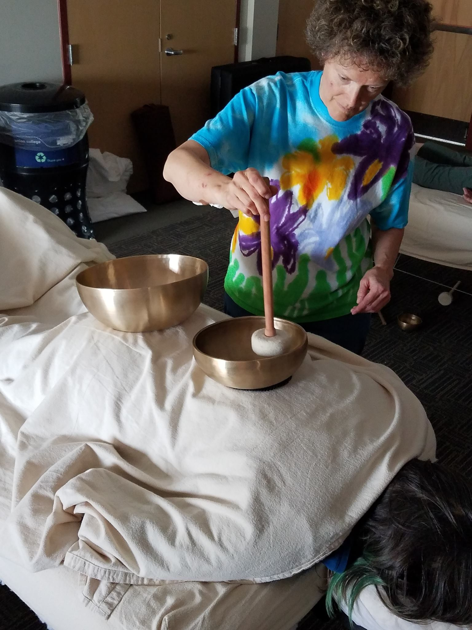 Margaret working with bowls on a client's back