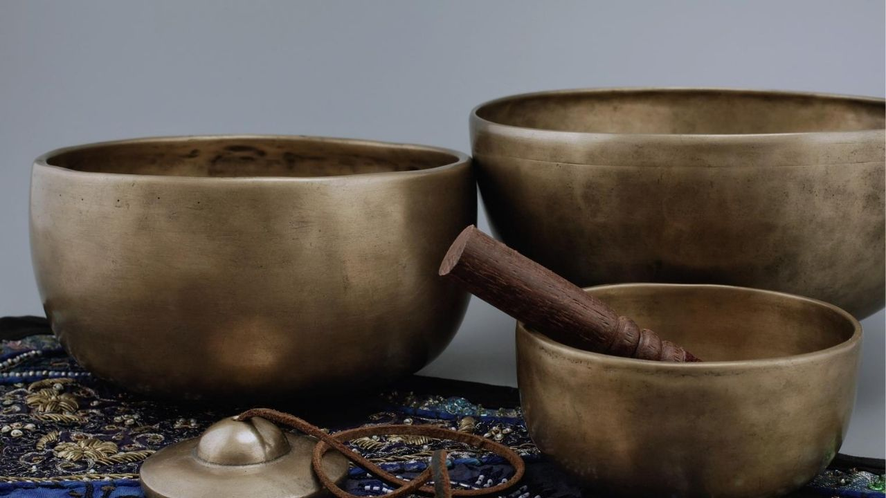 three metal singing bowls